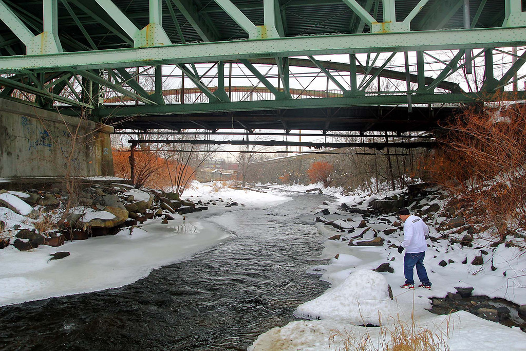 Description of . Jose Oliver the father of the missing Fitchburg boy Jeremiah Oliver, 5, takes his search for Jeremiah on Saturday in Fitchburg down to the Nashua River under Rollstone Street. SENTINEL & ENTERPRISE/JOHN LOVE