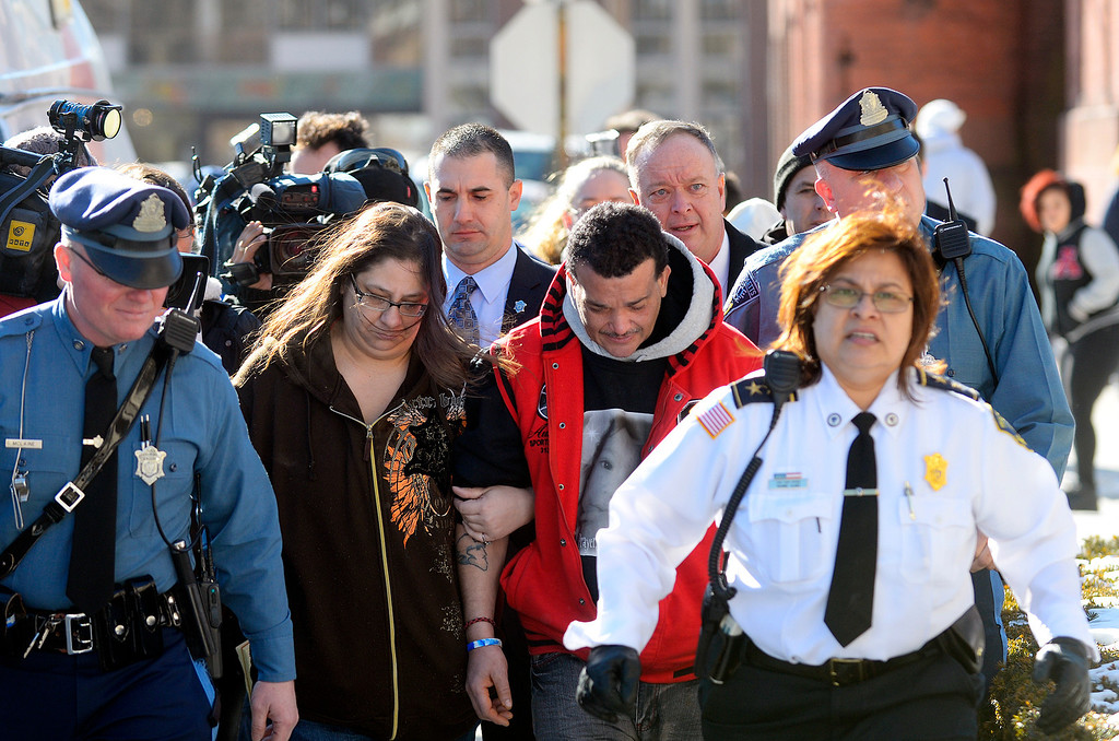 Description of . Sandrino Oliver (2nd from right), uncle of missing 5-year-old Jeremiah Oliver of Fitchburg, is escorted back into Fitchburg District Court after a verbal outbreak that started in the courtroom following the competency hearing of Elsa Oliver, Friday. Left of Sandrino is Rose Valcourt, Jeremiah's paternal aunt.  SENTINEL & ENTERPRISE / BRETT CRAWFORD