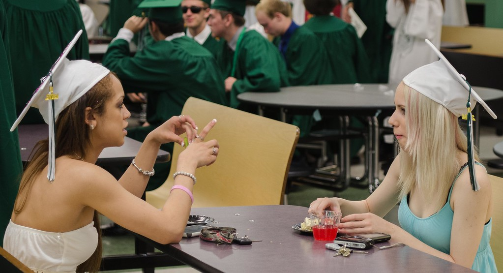 Amber Belton (L) and Shania Womble (R) both of Westminster relax prior to the Oakmont Graduation. SENTINEL AND ENTERPRISE /JIM MARABELLO