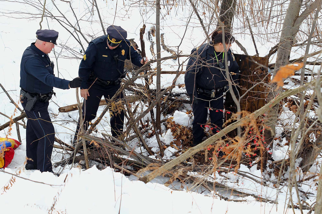 Description of . Fitchburg Police officers search and area near the Nashua River that searchers thought was of interset and they ruled it out during the search for Jeremiah Oliver, 5, the missing Fitchburg boy on Saturday. SENTINEL & ENTERPRISE/JOHN LOVE