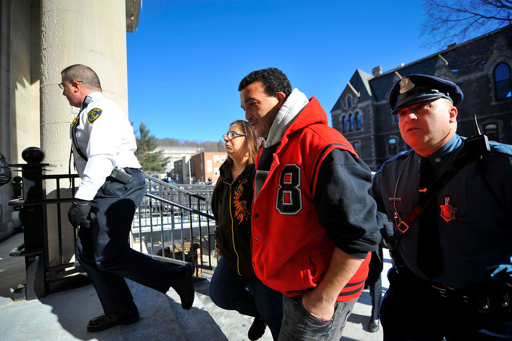 Description of . Sandrino Oliver (center), uncle of missing 5-year-old Jeremiah Oliver of Fitchburg, is escorted back into Fitchburg District Court after a verbal outbreak that started in the courtroom following the competency hearing of Elsa Oliver, Friday. Left of Sandrino is Rose Valcourt, Jeremiah's paternal aunt. SENTINEL & ENTERPRISE / BRETT CRAWFORD