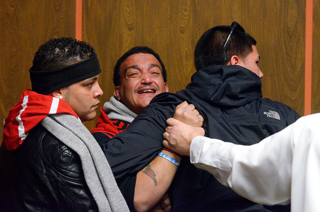 Description of . Father Jose Oliver of missing 5-year-old Jeremiah Oliver of Fitchburg stands by at left as Sandrino Oliver (2nd from left), is escorted out from Fitchburg District Court while yelling repeatedly,
