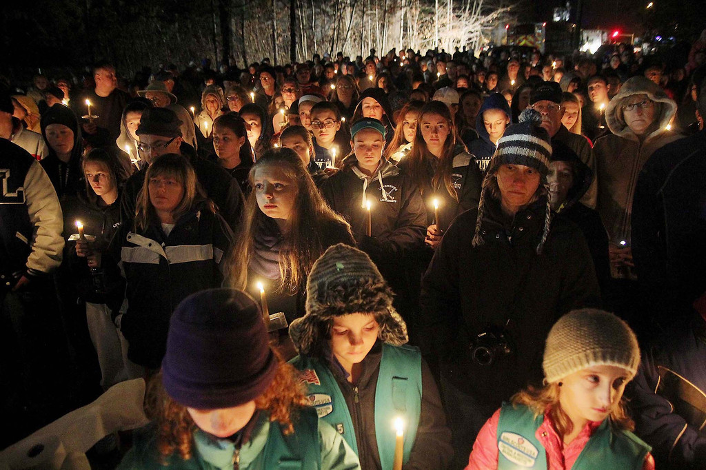 Description of . Many hold candles at the ceremony at the Lunenburg gazebo in support of student Isaac Phillips on Sunday night. SENTINEL & ENTERPRISE/ JOHN LOVE