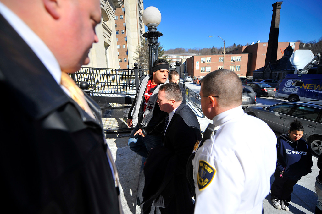 Description of . Jose Oliver (wearing headband), father of missing 5-year-old Jeremiah Oliver of Fitchburg is escorted back into Fitchburg District Court for a verbal outburst after the competency hearing of Elsa Oliver in Fitchburg District Court, Friday. SENTINEL & ENTERPRISE / BRETT CRAWFORD