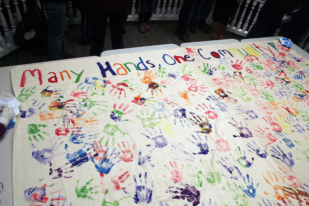 """. At a ceremony held at the Lunenburg town gazebo in support of Isacc Phillips, a Lunenburg eighth grader, they had a banner that read \""""Many Hands one Community\"""" that many but their handprints on.  SENTINEL & ENTERPRISE/ JOHN LOVE"""