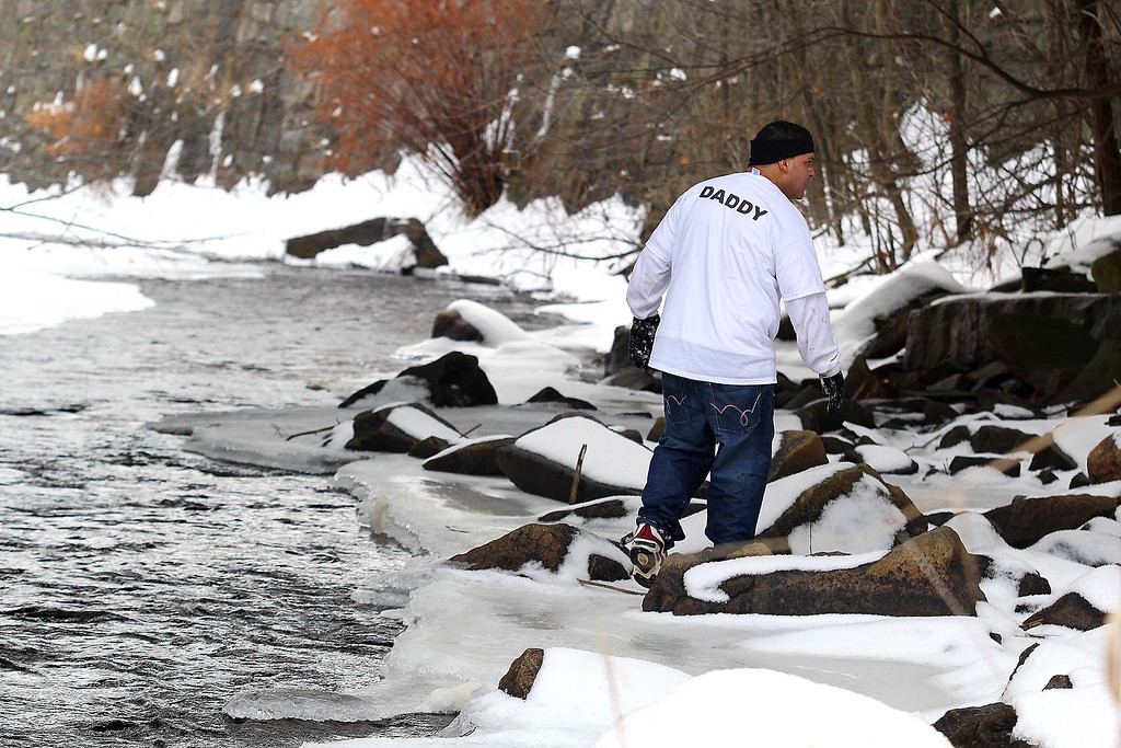 . Jose Oliver the father of the missing Fitchburg boy Jeremiah Oliver, 5, searches down by the Nashua River for Jeremiah on Saturday in Fitchburg. SENTINEL & ENTERPRISE/JOHN LOVE